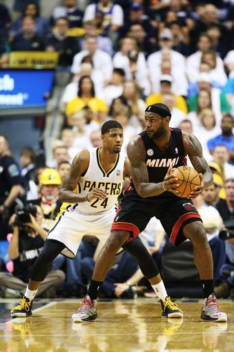 INDIANAPOLIS, IN - MAY 26: LeBron James #6 of the Miami Heat drives against Paul George #24 of the Indiana Pacers during Game Three of the Eastern Conference Finals at Bankers Life Fieldhouse on May 26, 2013 in Indianapolis, Indiana. (Photo by Andy Lyons/Getty Images)