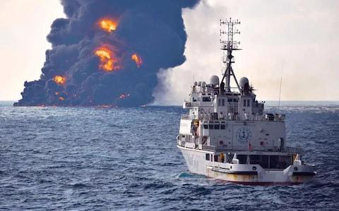 """Transport Ministry of China released on January 14, 2018 shows smoke and flames coming from the burning oil tanker """"Sanchi"""""""
