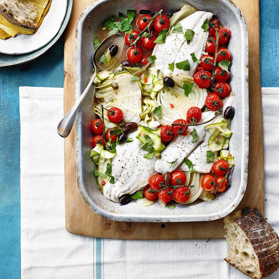 """<p>Based on the Italian dish pesce all'acqua pazza, but we've boosted the veg to make it more of a complete meal. Serve with bread to mop up the delicious juices.</p><p><strong>Recipe: <a href=""""https://www.goodhousekeeping.com/uk/food/recipes/a32168035/fish-traybake/"""" rel=""""nofollow noopener"""" target=""""_blank"""" data-ylk=""""slk:Fish in Crazy Water Traybake"""" class=""""link rapid-noclick-resp"""">Fish in Crazy Water Traybake</a></strong></p>"""