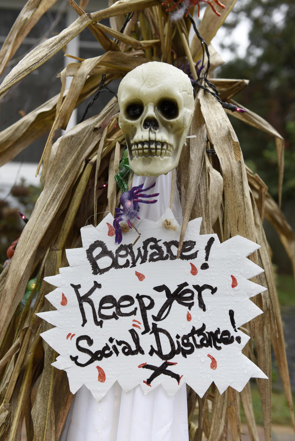Halloween decorations are seen at the home of Carol McCarthy, reminding people to be safe while trick-or-treating during the COVID-19 pandemic, Monday, Oct. 26, 2020, in Palmyra, N.J. (AP Photo/Michael Perez)