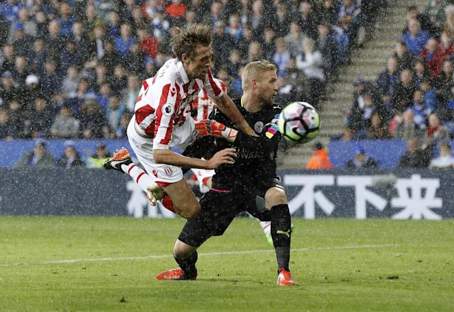 <p>Stoke City's Peter Crouch in action with Leicester City's Kasper Schmeichel </p>