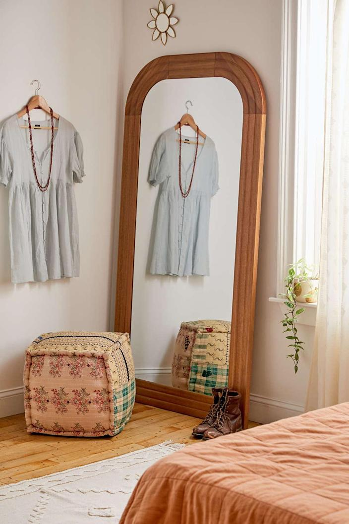 """For a more boho-themed home, try a wood frame like this one, in which the flattened arch construction blends two classic shapes. The two different tones of wood give this mirror presence in your living space. $499, Urban Outfitters. <a href=""""https://www.urbanoutfitters.com/shop/emelie-floor-mirror?color=111&type=REGULAR&size=ONE%20SIZE&quantity=1"""" rel=""""nofollow noopener"""" target=""""_blank"""" data-ylk=""""slk:Get it now!"""" class=""""link rapid-noclick-resp"""">Get it now!</a>"""