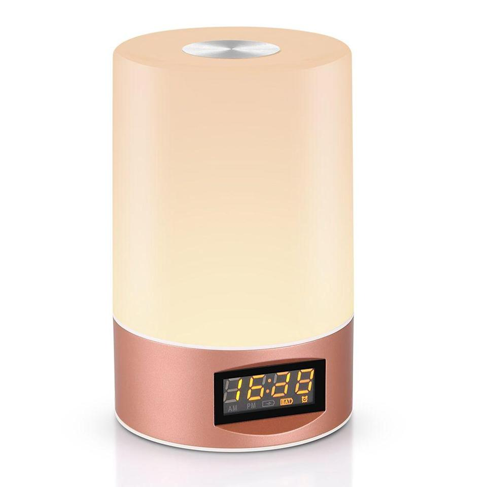 """<p><strong>Best For: Giftability</strong><br>Reviewers tout this three-light wake-up clock with additional color transition and sound settings as a quality gift and stylish home accent.</p><br><br><strong>Utorch</strong> Wake Up Light Touch Sensor Clock LED Bedside Lamp, $14.79, available at <a href=""""https://www.gearbest.com/table-lamps/pp_009387758048.html?wid=1214279"""" rel=""""nofollow noopener"""" target=""""_blank"""" data-ylk=""""slk:GearBest"""" class=""""link rapid-noclick-resp"""">GearBest</a>"""
