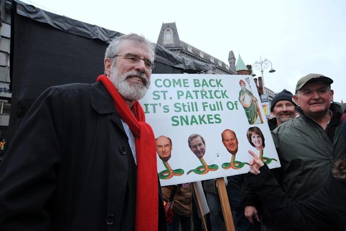 Sinn Fein leader Gerry Adams (L) poses with demonstrators during a march and rally organized by Right2Change and Right2Water in Dublin on February 20, 2016, protesting against water charges and calling for an end to austerity (AFP Photo/Caroline Quinn)