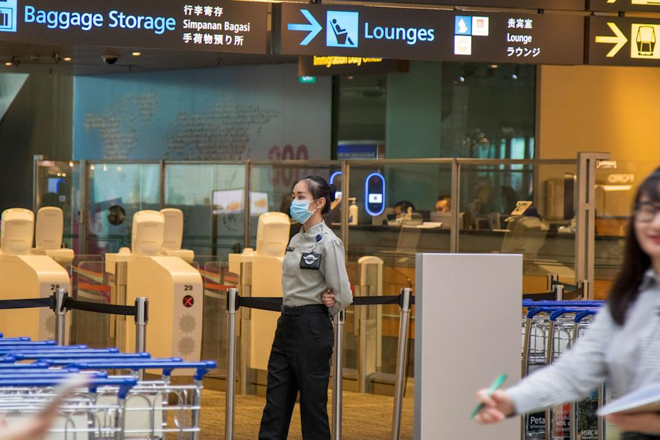 A security officer at Changi Airport's Terminal 3 seen wearing a face mask on 6 February 2020. (PHOTO: Dhany Osman / Yahoo News Singapore)
