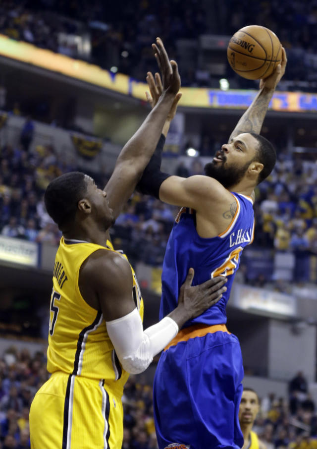 New York Knicks center Tyson Chandler, right, shoots over Indiana Pacers center Roy Hibbert during the first half of an NBA basketball game in Indianapolis, Thursday, Jan. 16, 2014. (AP Photo/Michael Conroy)