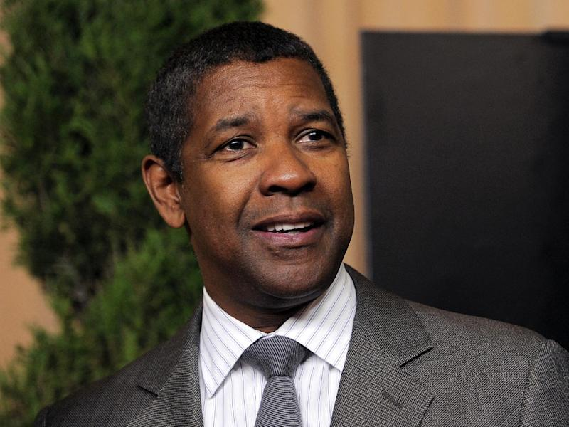 """FILE - In this Feb. 4, 2013 file photo, actor Denzel Washington, nominated for best actor in a leading role for """"Flight,"""" arrives at the 85th Academy Awards Nominees Luncheon in Beverly Hills, Calif. Tony Award winners Diahann Carroll and Denzel Washington will play mother and son on Broadway in a spring revival of the classic American play """"A Raisin in the Sun,"""" an opportunity that has left him """"overjoyed"""" and her """"thrilled."""" (Photo by Chris Pizzello/Invision/AP, File)"""