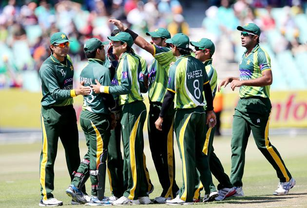 Pakistani players celebrate the wicket of South Africa's Farhaan Behardien during the 4th Momentum ODI match at Sahara Stadium Kingsmead on March 21, 2013 in Durban.  AFP PHOTO  / STR        (Photo credit should read STR/AFP/Getty Images)