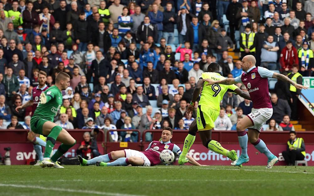 Alan Hutton tries (but fails) to put Mendes off from scoring his and Reading's second - Credit: JASONPIX/REX/Shutterstock