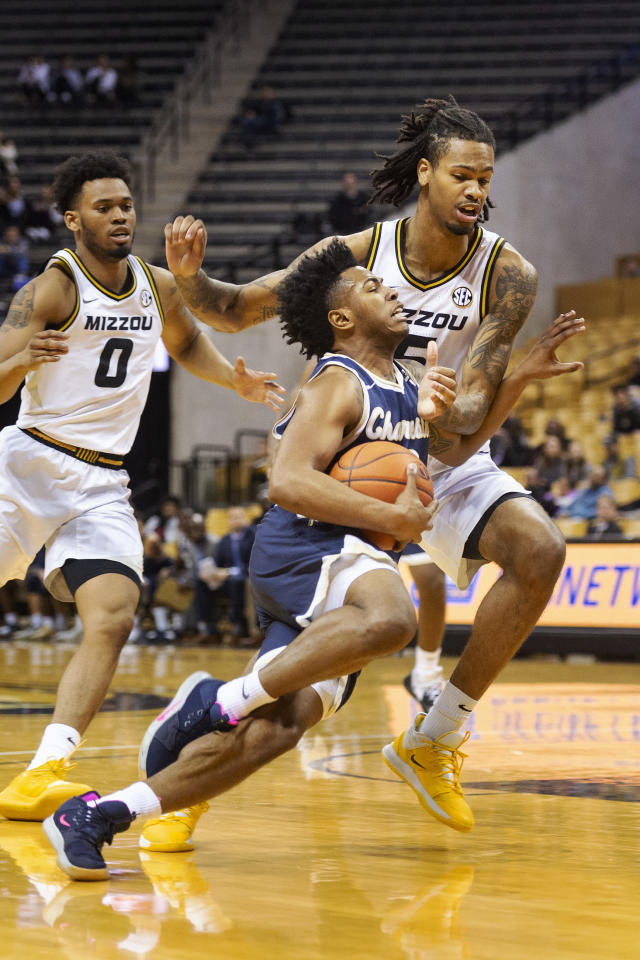 Charleston Southern's Travis Anderson, center, gets tangled up with Missouri's Mitchell Smith, right, as he drives past Torrence Watson, left, during the first half of an NCAA college basketball game Tuesday, Dec. 3, 2019, in Columbia, Mo. (AP Photo/L.G. Patterson)