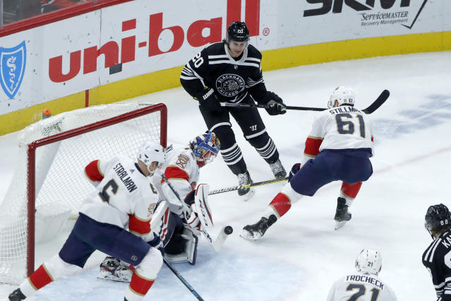 Florida Panthers goaltender Sergei Bobrovsky makes a stick save on a shot by Chicago Blackhawks' Brandon Saad (20) as Anton Stralman (6) and Riley Stillman (61) also defend during the first period of an NHL hockey game Tuesday, Jan. 21, 2020, in Chicago. (AP Photo/Charles Rex Arbogast)