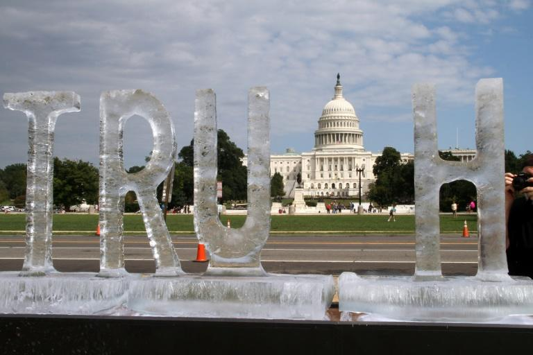 """A T was the first letter of the ice sculpture spelling out the word """"truth"""" to collapse"""