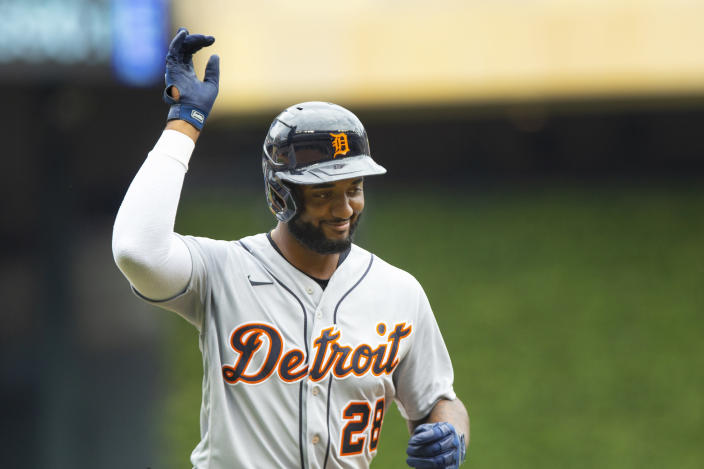 Detroit Tigers third baseman Niko Goodrum (28) reacts to the crowd after hitting a home run against the Minnesota Twins in the first inning of a baseball game, Saturday, July 10, 2021, in Minneapolis. (AP Photo/Andy Clayton-King)