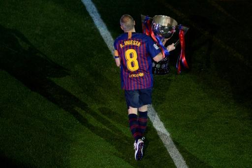 Farewell: Barcelona's Andres Iniesta holds the Liga trophy