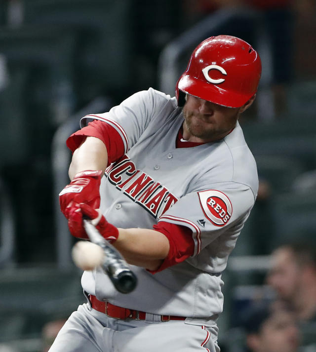 Cincinnati Reds right fielder Scott Schebler (43) connects on a solo-home run in the fifth Inning of a baseball game against the Atlanta Braves Monday, June 25, 2018, in Atlanta.(AP photo/John Bazemore)