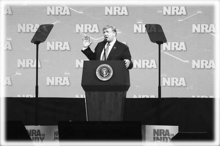 President Trump speaks at the National Rifle Association Institute for Legislative Action Leadership Forum in Indianapolis earlier this year. (Photo: Michael Conroy/AP, digitally enhanced by Yahoo News)