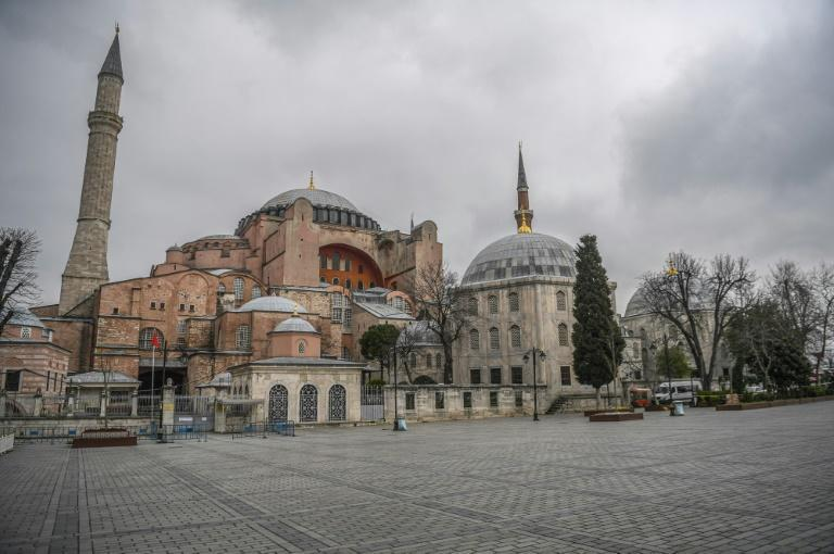 The square in front of the iconic Hagia Sophia in Istanbul is deserted with Turkish officials having repeatedly urged citizens to stay at home and respect social distancing rules -- but authorities have stopped short of a complete confinement