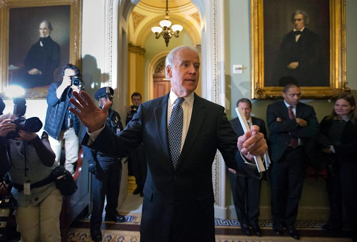 """In 2012, then-Vice President Joe Biden was instrumental in closing the """"fiscal cliff"""" deal with Senate Majority Leader Mitch McConnell (R-Ky.). (Photo: ASSOCIATED PRESS)"""