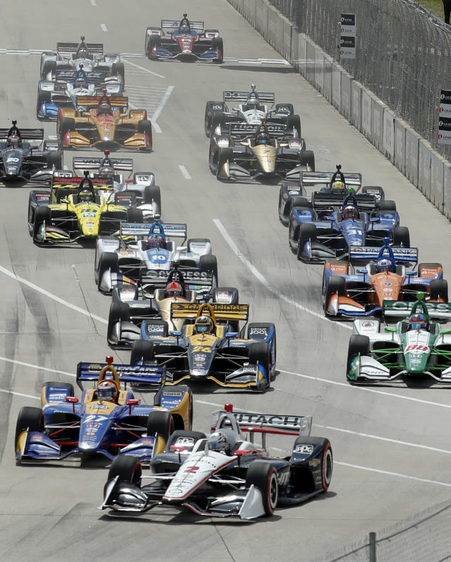 Josef Newgarden leads the field into turn one during the second race of the IndyCar Detroit Grand Prix auto racing doubleheader in Detroit, Sunday, June 2, 2019. (AP Photo/Paul Sancya)