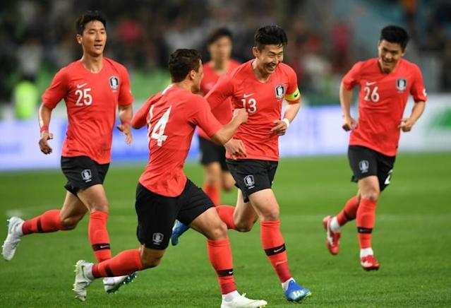 South Korea's Son Heung-min (2R) celebrates his goal during a friendly football match against Honduras in Deagu on May 28, 2018