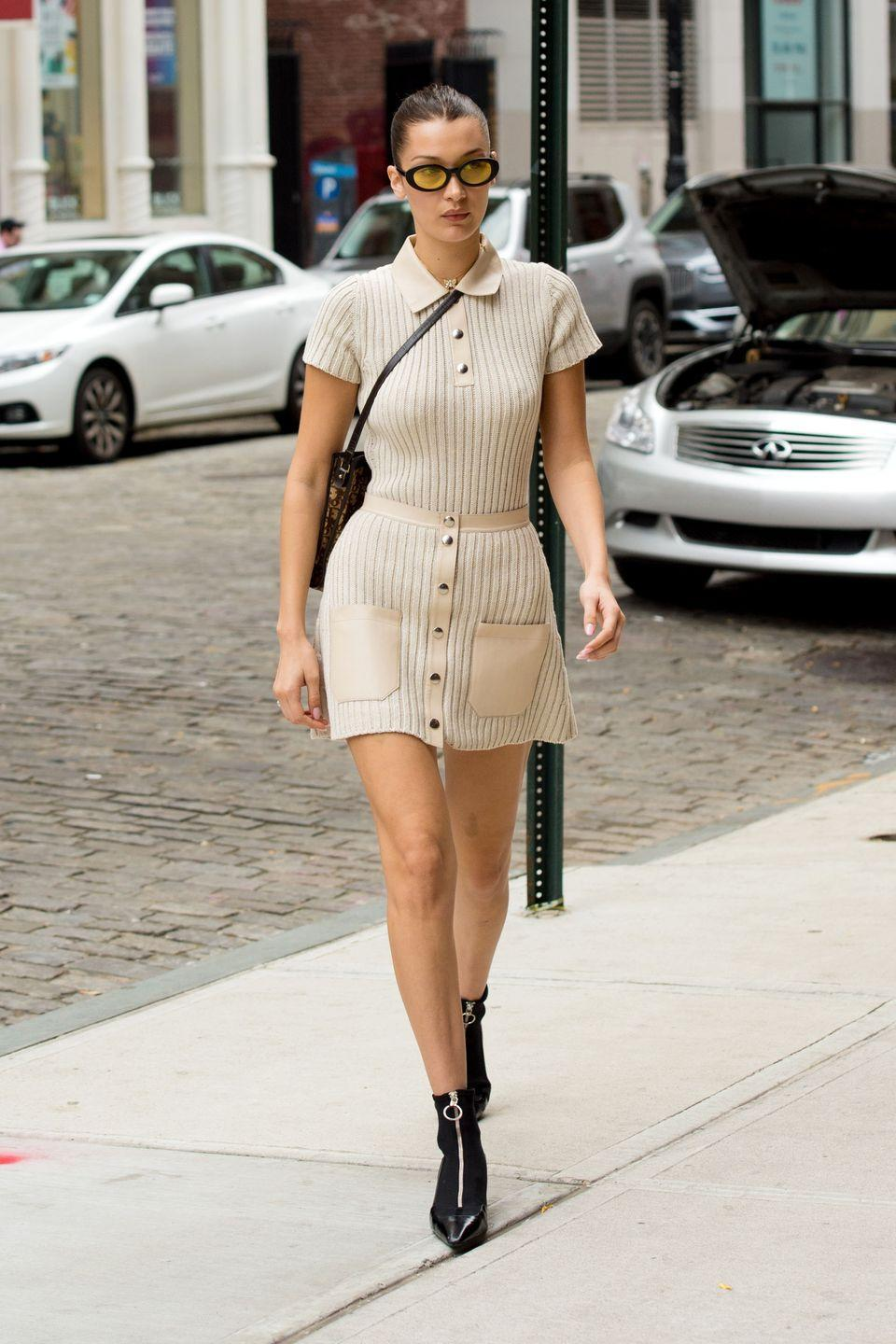 <p>In a nude ribbed polo and skirt by Alyx, Dior sling bag, pointed-toe zip-up boots, and yellow-tinted sunglasses while out in New York.</p>