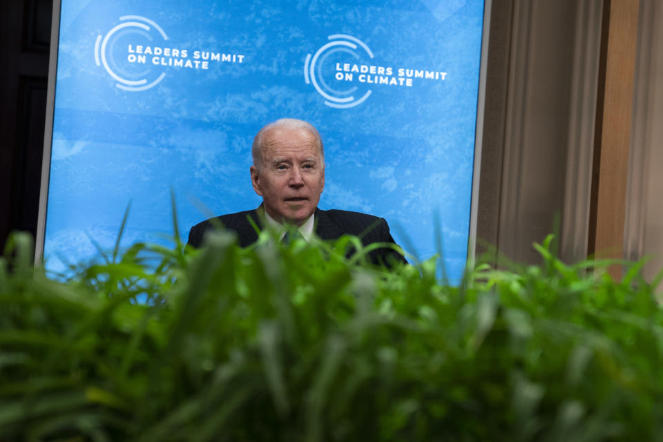 President Joe Biden sits down after speaking to the virtual Leaders Summit on Climate, from the East Room of the White House, Friday, April 23, 2021, in Washington. (AP Photo/Evan Vucci)