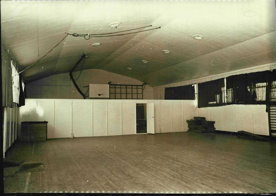 <p>Are you having a middle school flashback? From the wooden floor to the paneled room divider, it doesn't seem like school gymnasiums have changed much over the past few decades. </p>