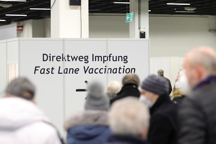 COLOGNE, GERMANY - FEBRUARY 08: Senior citizens queue up for a vaccination against COVID-19 at a vaccine center built in a hall of the Koeln Messe trade fair grounds during the second wave of the coronavirus pandemic on February 08, 2021 in Cologne, Germany. The 53 vaccine centers across North Rhine-Westphalia are opening their doors today to administer vaccines, mostly against people over 80 years old. Germany has experienced a hampered vaccine rollout due to production setbacks for all three of the vaccine so far approved in the European Union. (Photo by Andreas Rentz/Getty Images)