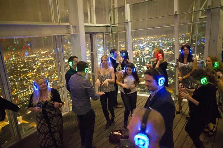 Partygoers attend a silent disco at the 'Shard' tower, on the south bank of the river Thames in central London, on November 15, 2014 (AFP Photo/Justin Tallis)