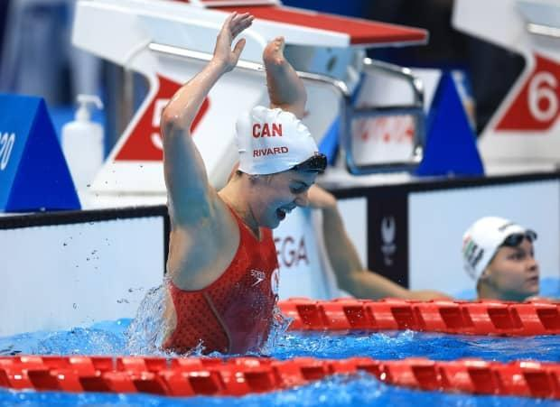 Aurélie Rivard of Canada reacts after winning the gold medal and breaking her world record time in the women's S10 100-metre freestyle final. (Buda Mendes/Getty Images - image credit)