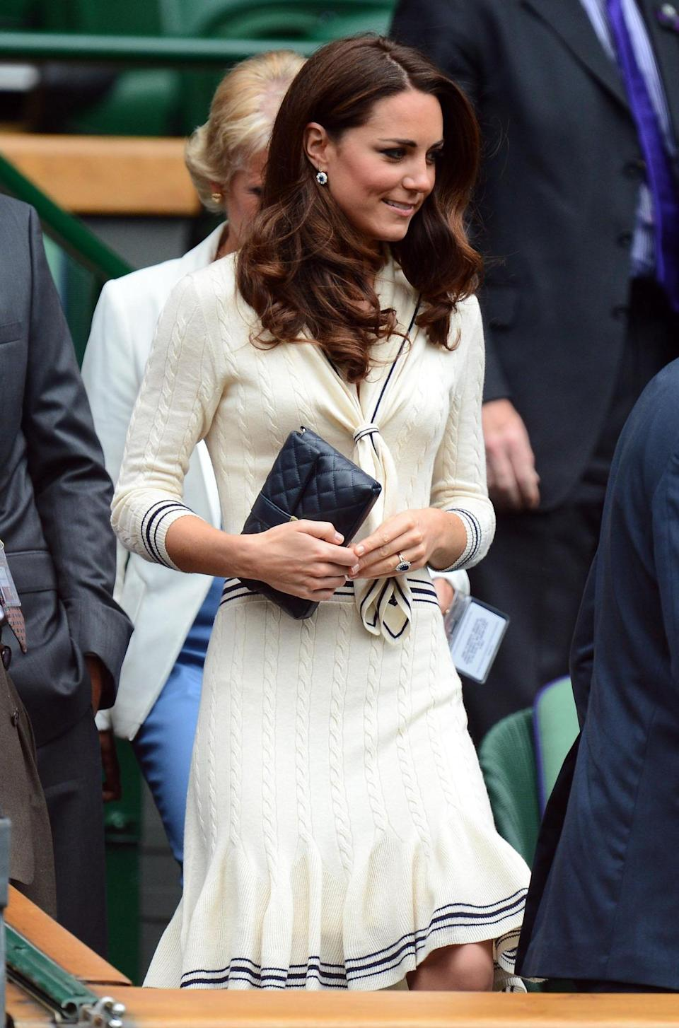 <p>Kate wore a knitted sailor dress by Alexander McQueen to Wimbledon. She carried a quilted Jaeger bag to finish off the look.</p><p><i>[Photo: PA]</i></p>