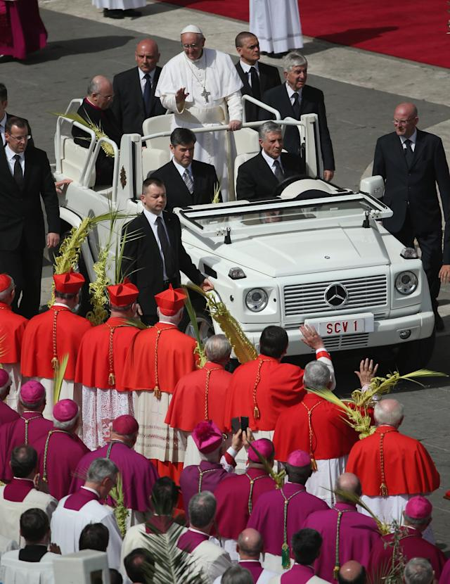 VATICAN CITY, VATICAN - MARCH 24: Pope Francis greets cardinals and bishops after conducting Palm Sunday Mass on March 24, 2013 in Vatican City, Vatican. Pope Francis lead his first mass of Holy Week as pontiff by celebrating Palm Sunday in front of thousands of faithful and clergy. The pope's first holy week will also incorporate him washing the feet of prisoners in a youth detention centre in Rome next Thursday, 28th March. (Photo by Christopher Furlong/Getty Images)