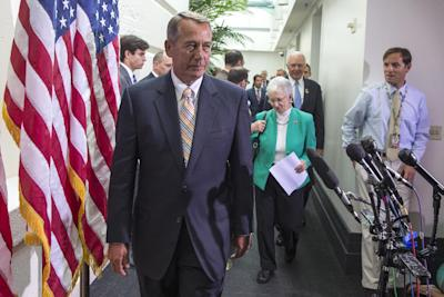 House Speaker John Boehner of Ohio, followed by Rep. Virginia Foxx, R-N.C., and others, arrives for a news conference on Capitol Hill, in Washington, Wednesday, July 9, 2014. Boehner addressed questions on a $3.7 billion request for emergency funds to secure the U.S. and Mexican border. (AP Photo/ Evan Vucci)