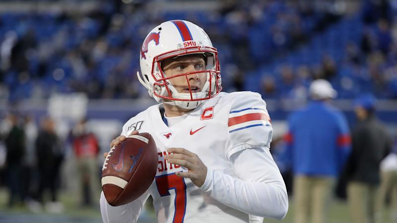 SMU quarterback Shane Buechele warms up before the start of an NCAA college football game against Memphis Saturday, Nov. 2, 2019, in Memphis, Tenn. (AP Photo/Mark Humphrey)
