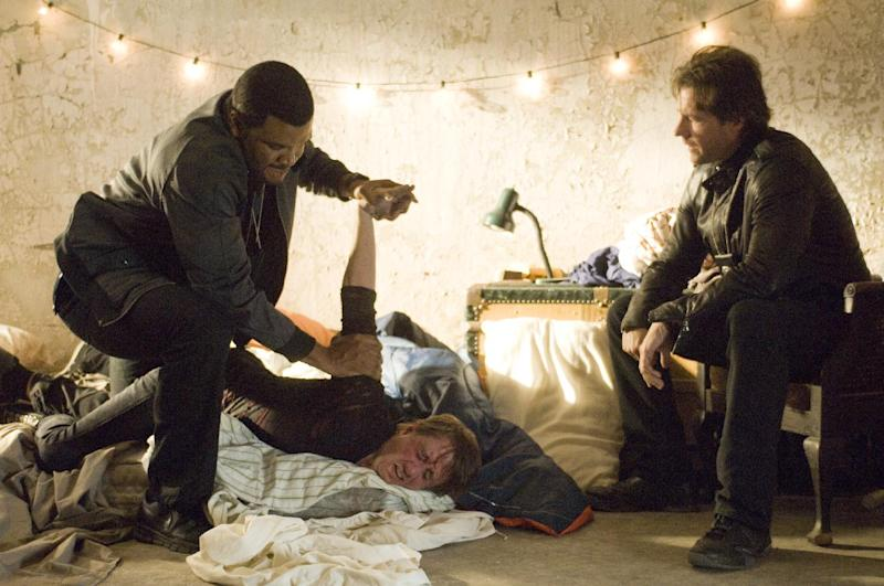 """This film image released by Summit Entertainment shows Edward Burns, right, and Tyler Perry in a scene from """"Alex Cross."""" (AP Photo/Summit Entertainment)"""