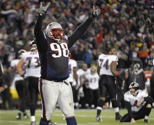 New England Patriots defensive tackle Gerard Warren celebrates after the Baltimore Ravens missed a 32-yard field goal attempt during the AFC Championship NFL football game against the Baltimore Ravens Sunday, Jan. 22, 2012, in Foxborough, Mass. The Patriots defeated the Ravens 23-20 to win the AFC Championship. (AP Photo/Elise Amendola)