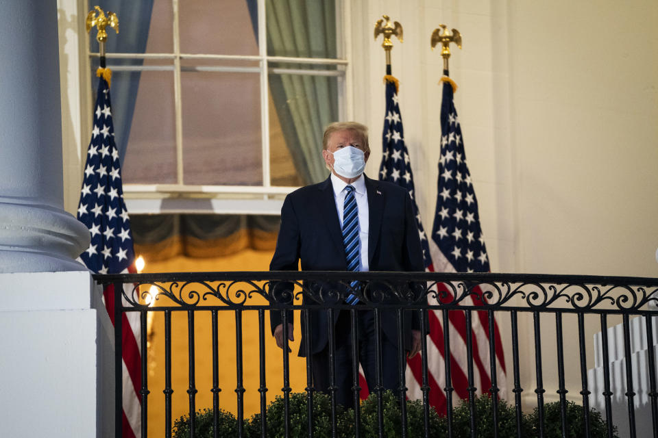 President Donald J. Trump wearing a face mask watches Marine One from the Truman Balcony as he returns home after receiving treatments for coronavirus on Monday, Oct 05, 2020. (Photo by Jabin Botsford/The Washington Post via Getty Images)