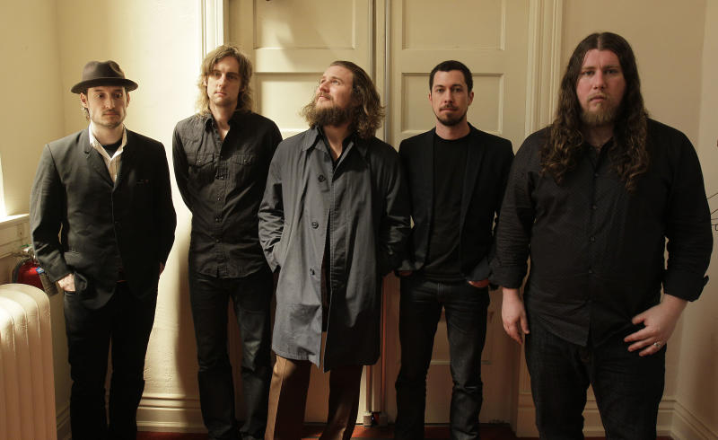 "In this Wednesday, April 13, 2011 photo, members of My Morning Jacket, from left, Bo Koster, Carl Broemel, Jim James, Tom Blankenship and Patrick Hallahan pose for a photograph in Louisville, Ky. James says the the Kentucky quintet's much-anticipated new album, ""Circuital,"" reflects a search he's been on for some time. (AP Photo/Ed Reinke)"