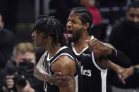 Los Angeles Clippers guard Terance Mann, left, celebrates with guard Paul George after scoring and drawing a foul during the first half in Game 6 of a second-round NBA basketball playoff series against the Utah Jazz Friday, June 18, 2021, in Los Angeles. (AP Photo/Mark J. Terrill)