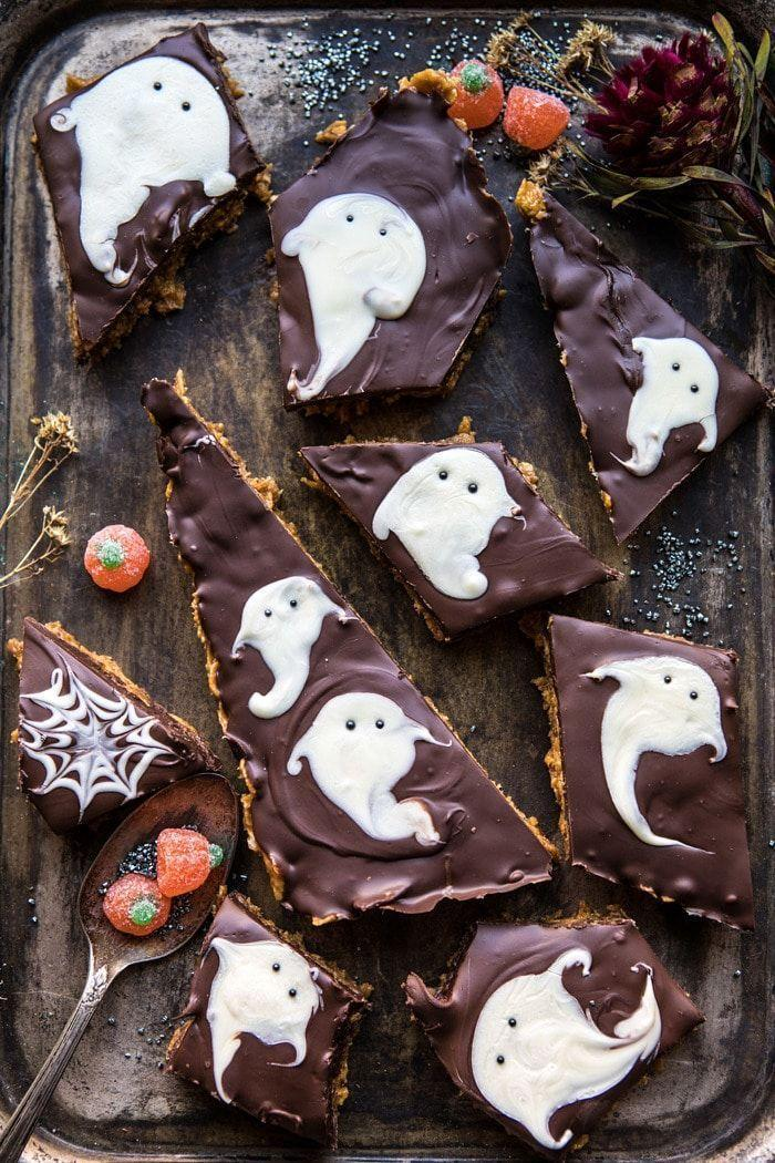 """<p>Six ingredients and thirty minutes, plus a little imagination. That's all you need to whip up these beauties.</p><p><strong>Get the recipe at <a href=""""https://www.halfbakedharvest.com/boo-chocolate-peanut-butter-bars/"""" rel=""""nofollow noopener"""" target=""""_blank"""" data-ylk=""""slk:Half Baked Harvest"""" class=""""link rapid-noclick-resp"""">Half Baked Harvest</a>.</strong></p><p><strong><a class=""""link rapid-noclick-resp"""" href=""""https://go.redirectingat.com?id=74968X1596630&url=https%3A%2F%2Fwww.walmart.com%2Fip%2FThe-Pioneer-Woman-Spring-10-Piece-Baking-Prep-Set-Teal%2F269954471&sref=https%3A%2F%2Fwww.thepioneerwoman.com%2Ffood-cooking%2Fmeals-menus%2Fg32110899%2Fbest-halloween-desserts%2F"""" rel=""""nofollow noopener"""" target=""""_blank"""" data-ylk=""""slk:SHOP BAKING TOOLS"""">SHOP BAKING TOOLS</a><br></strong></p>"""