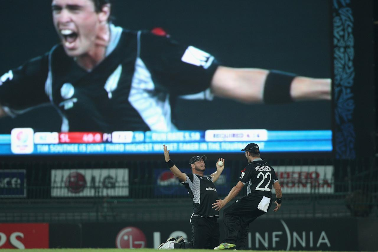 COLOMBO, SRI LANKA - MARCH 29:  Jesse Ryder (L) of New Zealand celebrates with Kane Williamson (R) after taking a catch to dismiss Upul Tharanga off the bowling of Tim Southee during the 2011 ICC World Cup Semi-Final match between New Zealand and Sri Lanka at the R. Premadasa Stadium on March 29, 2011 in Colombo, Sri Lanka.  (Photo by Michael Steele/Getty Images)