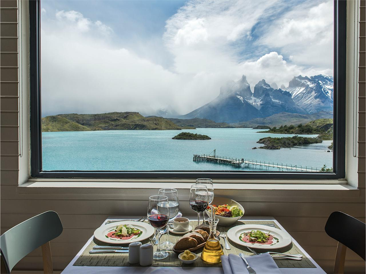 Overlooking Lake Pehoé, this hotel is home to a huge 14,830-acre equine facility and sits at the bottom of the picturesque Patagonian mountains.