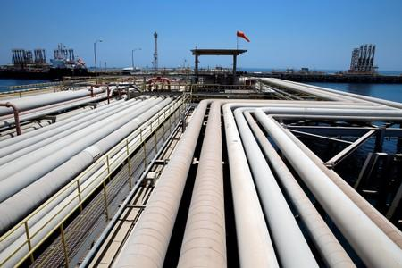 An oil tanker is being loaded at Saudi Aramco's Ras Tanura oil refinery and oil terminal in Saudi Arabia