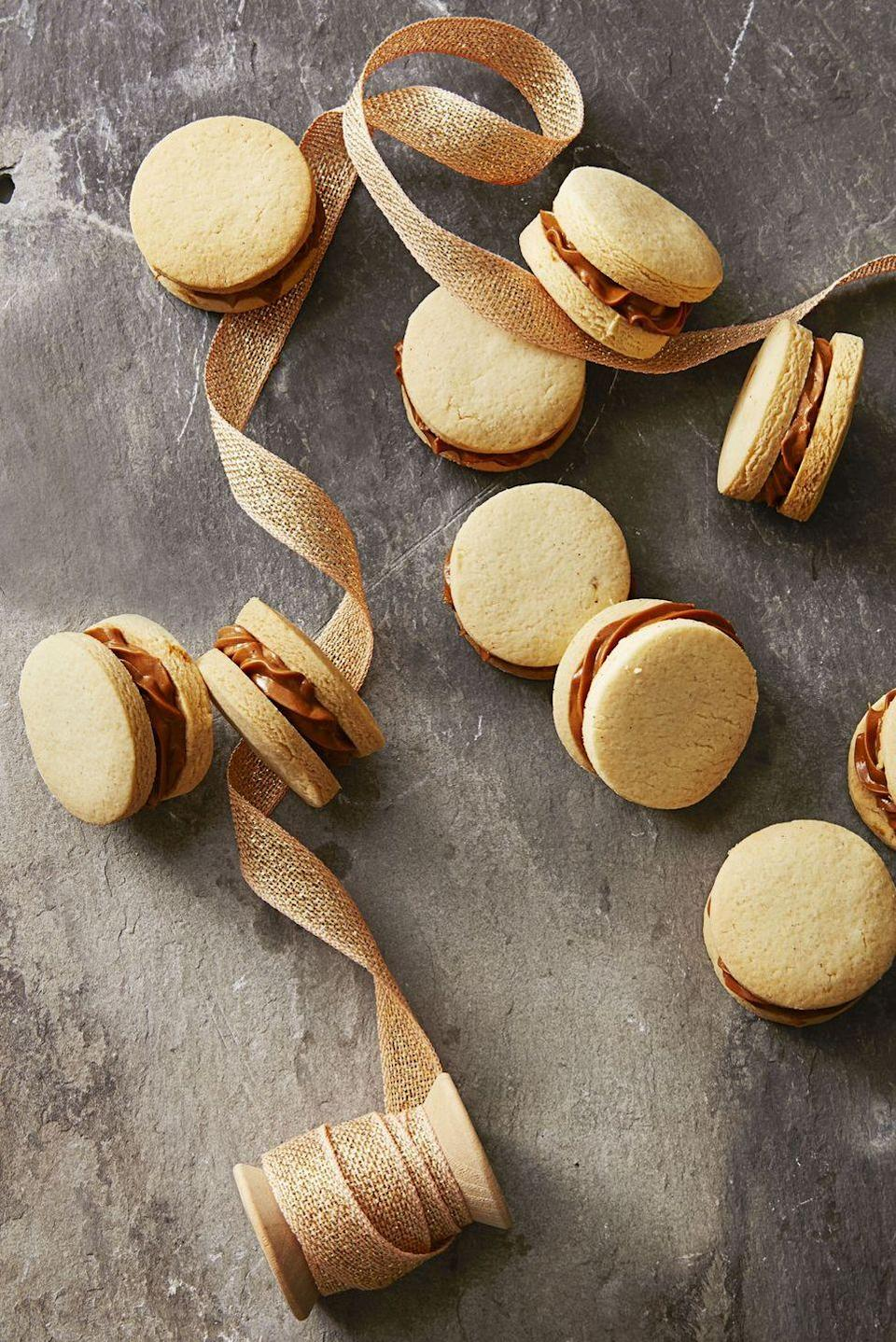 """<p>Because spring still deserves some decadence, make these coin-sized cookie sandwiches using store-bought, or homemade, caramel sauce.</p><p><em><a href=""""https://www.goodhousekeeping.com/food-recipes/dessert/a35757/dulce-de-leche-sandwiches/"""" rel=""""nofollow noopener"""" target=""""_blank"""" data-ylk=""""slk:Get the recipe for Dulce De Leche Sandwich Cookies »"""" class=""""link rapid-noclick-resp"""">Get the recipe for Dulce De Leche Sandwich Cookies »</a></em></p>"""