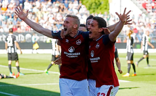 Soccer Football - 2. Bundesliga - SV Sandhausen v Nuremberg - BWT-Stadion am Hardtwald, Sandhausen, Germany - May 6, 2018 Nurnberg 's Hanno Behrens celebrates scoring their first goal with team mates REUTERS/Kai Pfaffenbach DFL RULES TO LIMIT THE ONLINE USAGE DURING MATCH TIME TO 15 PICTURES PER GAME. IMAGE SEQUENCES TO SIMULATE VIDEO IS NOT ALLOWED AT ANY TIME. FOR FURTHER QUERIES PLEASE CONTACT DFL DIRECTLY AT + 49 69 650050 TPX IMAGES OF THE DAY