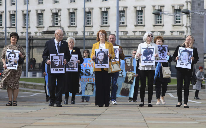 Family members arrive for the inquest into the Ballymurphy shooting, in Belfast, Northern Ireland, Tuesday May 11, 2021. The findings of the inquest into the deaths of 10 people during an army operation in August 1971 is due to be published on Tuesday. (AP Photo/Peter Morrison)