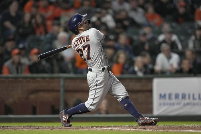 Houston Astros' Jose Altuve watches his solo home run against the San Francisco Giants during the fifth inning of a baseball game Friday, July 30, 2021, in San Francisco. (AP Photo/Tony Avelar)