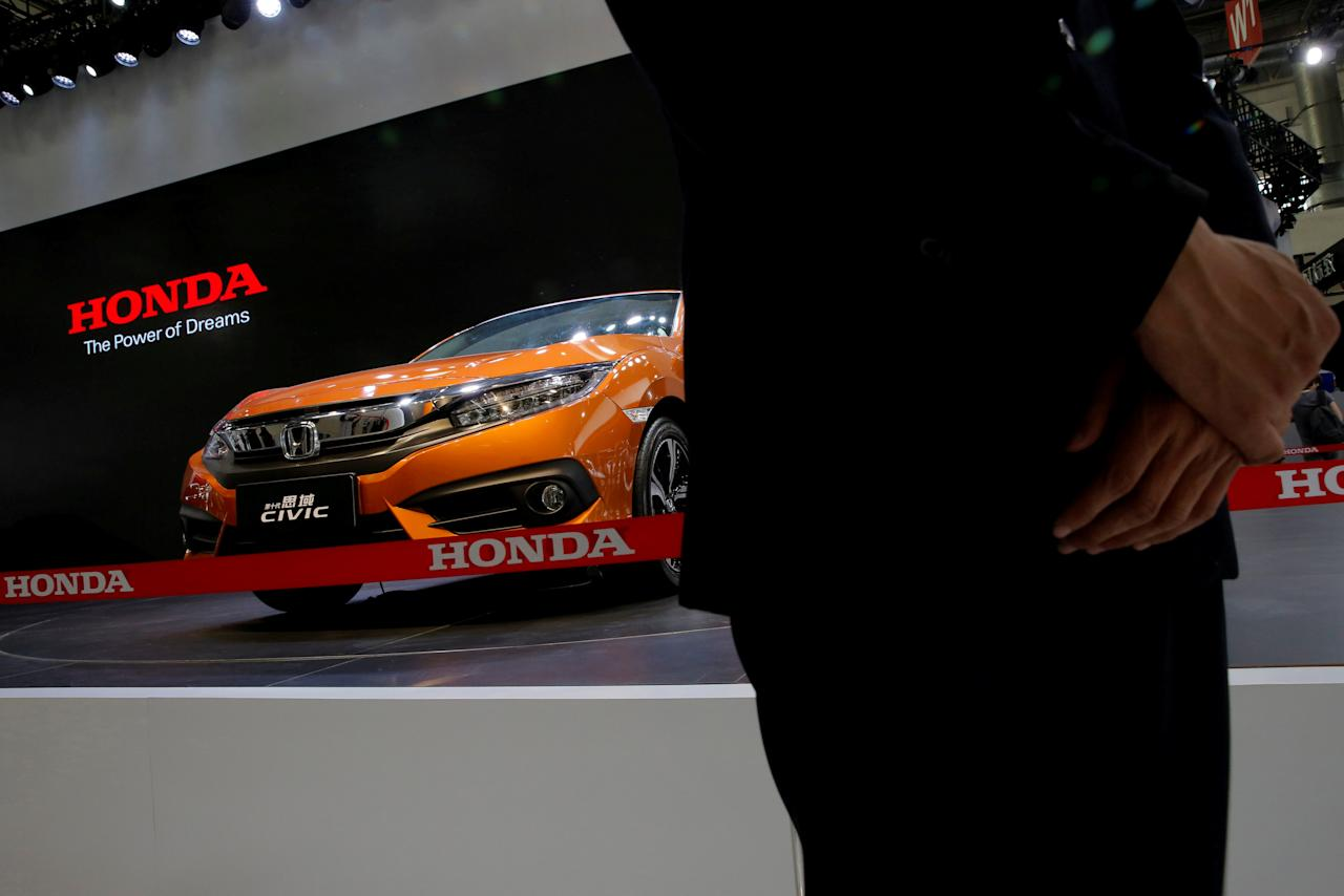 A security guard stands in front of a Honda's CIVIC model during the Auto China 2016 show in Beijing, China April 25, 2016. REUTERS/Kim Kyung-Hoon/File Photo