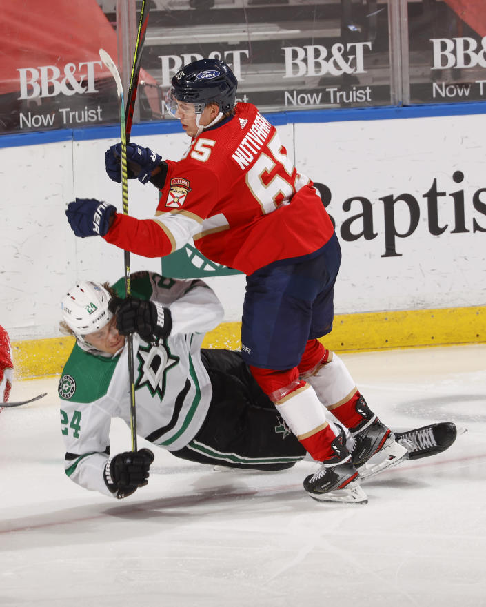 Florida Panthers defenseman Markus Nutivaara (65) takes Dallas Stars left wing Roope Hintz (24) to the ice during the second period of an NHL hockey game, Monday, May 3, 2021, in Sunrise, Fla. (AP Photo/Joel Auerbach)