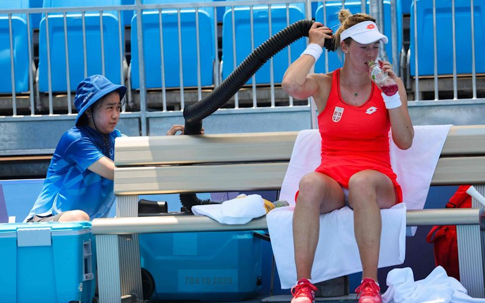 Serbia's Nina Stojanovic cools off with air conditioning during her women's singles first round match against Japan's Nao Hibino - GETTY IMAGES